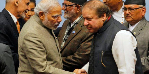 Pakistani Prime Minister Nawaz Sharif, right, moves closer to listen to Indian Prime Minister Narendra...