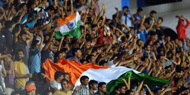 India's fans cheer after their team scored a goal during the Asia Group D FIFA World Cup 2018 qualifying...