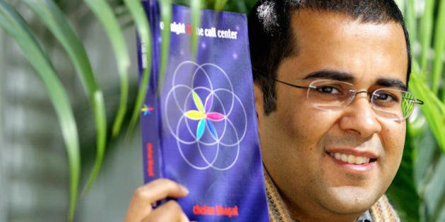 HONG KONG, CHINA: Investment banker Chetan Bhagat poses with his novel in Hong Kong, 23 December 2005....