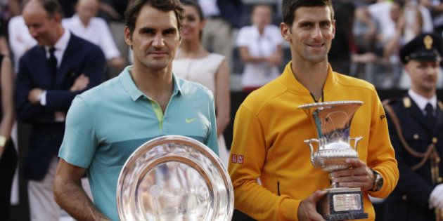 Serbia's Novak Djokovic, right and Switzerland's Roger Federer pose after their final match at the Italian...