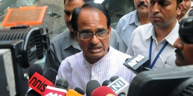 Indian Chief Minister of the state of Madhya Pradesh Shivraj Singh Chauhan talks to media outside the...