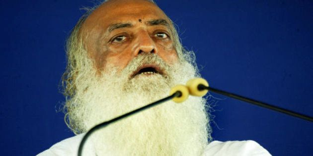Indian spiritual leader Asaram Bapu addresses supporters at the sect's Ashram (Spiritual Centre) on the...