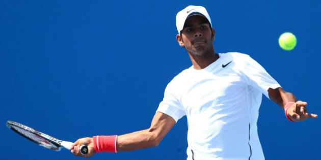 MELBOURNE, AUSTRALIA - JANUARY 19: Sumit Nagal of India in action in their first round doubles match...