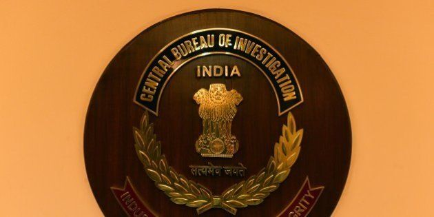 The logo of India's Central Bureau of Investigation (CBI) is seen during a press conference by newly-elected...