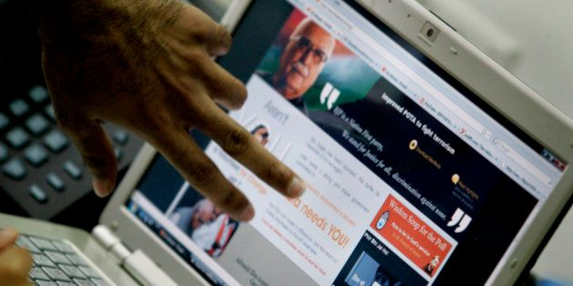 Web designer's fingers are seen as they discuss a web page of India's opposition Bharatiya Janata Party's...