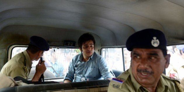 Vismay Shah (C) sits inside a police vehicle after a court sentenced him to five years in prison in a...