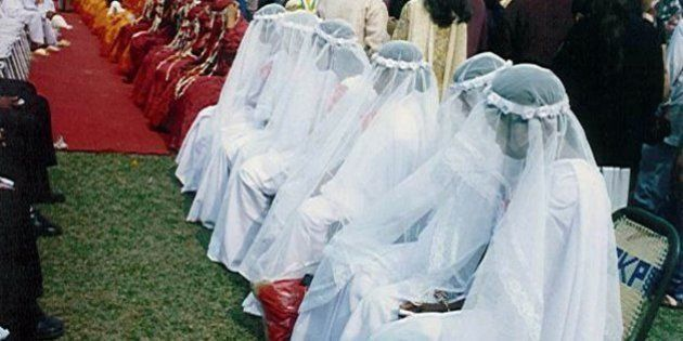 Christians in white wedding gowns, Muslims in red burqas, and Hindus in yellow sarees wait for a marriage...