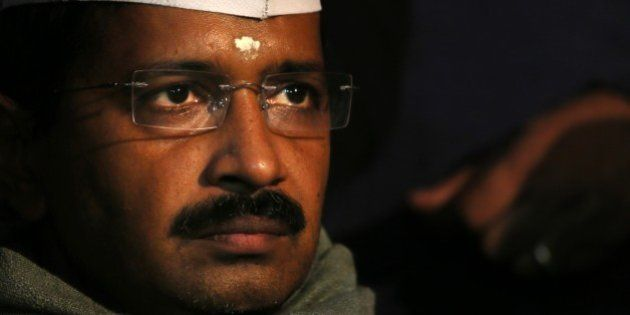 Aam Aadmi Party, or Common Man's Party, leader Arvind Kejriwal listens to a speaker during a public meeting...