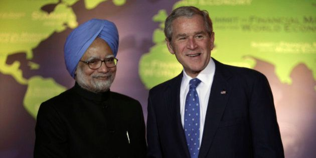 President George W. Bush, right, shakes hands with Indian Prime Minister Manmohan Singh on Saturday,...