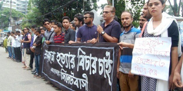 Bangladeshis protest against the beating death of a 13-year-old boy in Sylhet on July 13, 2015. Bangladesh...