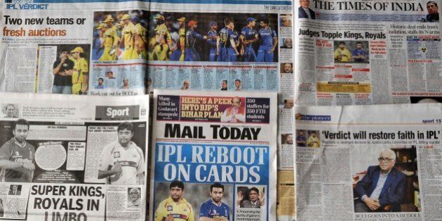This photo illustration taken in New Delhi on July 15, 2015, shows Indian media coverage of the suspension...