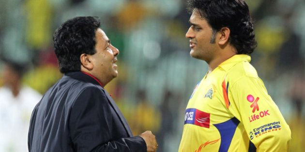 Chennai Super Kings Captain MD Dhoni (R) speaks with IPL Chairman Rajeev Shukla (L) during the IPL Twenty20...