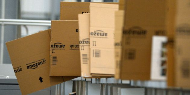 Empty boxes are stacked in the packaging department at the Fulfilment Centre for online retail giant...