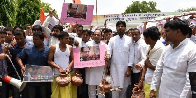 Indian Youth Congress (IYC) activists shout anti-government slogans as they take part in a mock Hindu...