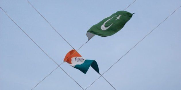At the end of the guard changing ceremony at the Pakistan-India border the respective flags are