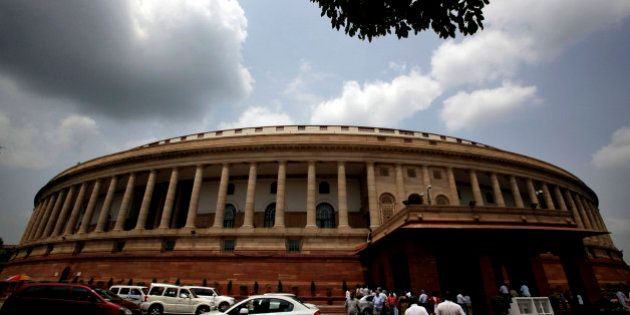 Traffic flows in front of Indian Parliament House on the first day of monsoon session in New Delhi, India,...