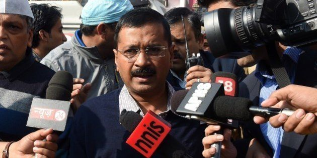 Aam Adami Party (AAP) candidate for Delhi chief minister, Arvind Kejriwal arrives to cast his vote at...