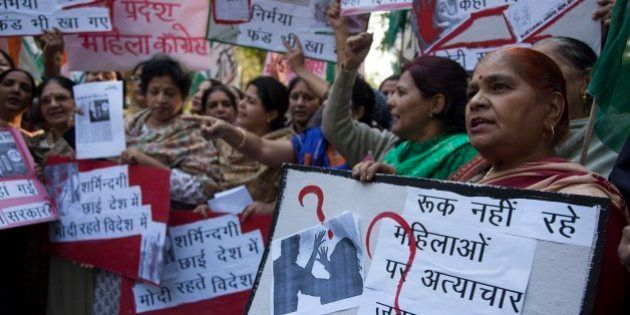 India's opposition Congress party's women activists hold placards during a protest after a woman...