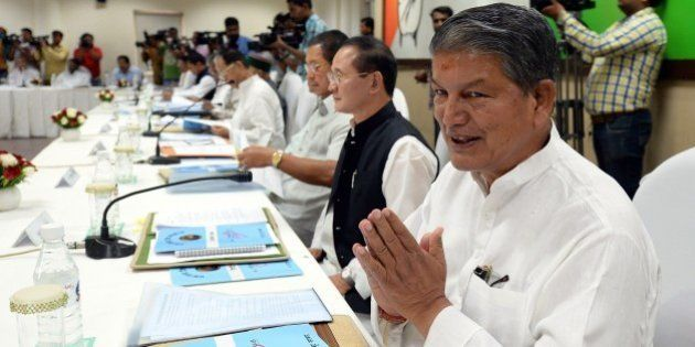 Uttarakhand Chief Minister Harish Rawat gestures during a meeting at party headquarters in New Delhi...