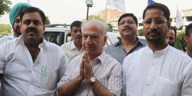 Bharatiya Janata Party (BJP) leader in charge of Punjab's affairs, Shanta Kumar (C), attends a meeting...