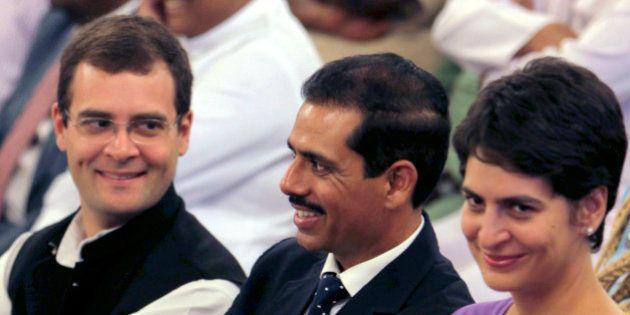 Congress party leader Rahul Gandhi, left, his sister Priyanka Vadra, right, and her husband Robert Vadra...