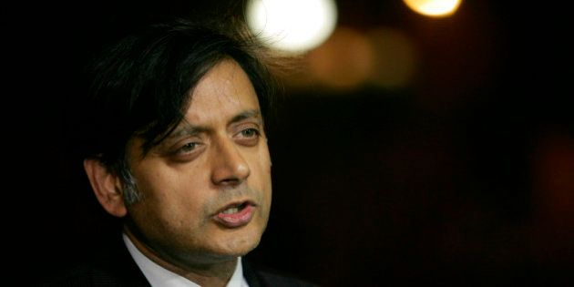 FILE- In this June 19, 2006 file photograph, India's junior foreign minister Shashi Tharoor, then a United...