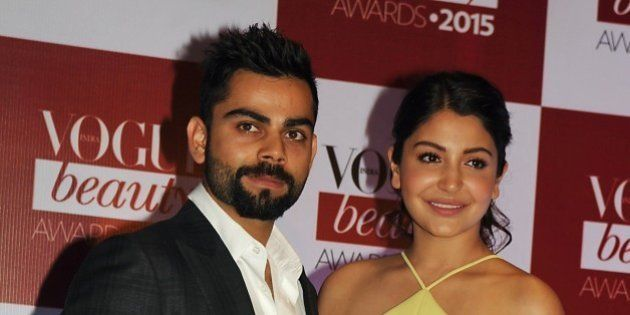 Indian Bollywood actress Anushka Sharma and Indian cricketer Virat Kohli (L) attend the Vogue Beauty...