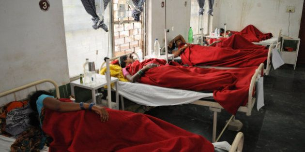 Indian women who underwent sterilization surgeries receive treatment at the District Hospital in Bilaspur,...