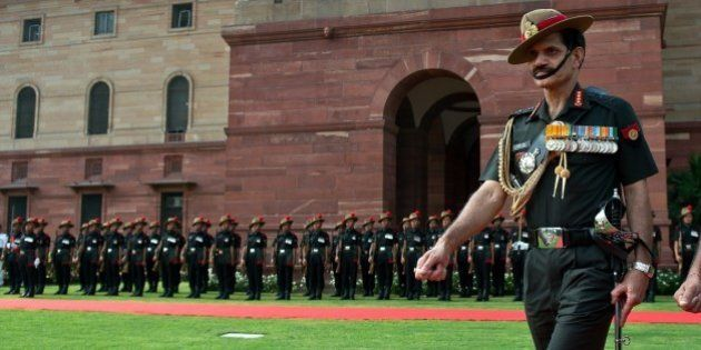 Incoming head of the Indian Army Lt. General Dalbir Singh Suhag inspects a guard of honour prior to joining...