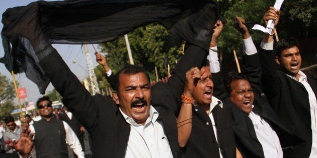 Indian lawyers shout slogans during a protest against the visit of Pakistani Prime Minister Raja Pervaiz...