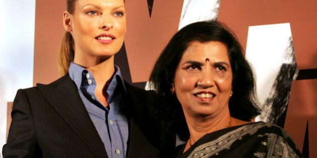 Canadian supermodel Linda Evangelista, left, and Director of Y.R. Gaitonde Center for AIDS Research and Education (Y.R.G. CARE) Suniti Solomon pose for photographers during a function to donate a check of US$ 250,000 from M.A.C., a professional makeup company, to Indian AIDS/HIV charity, in Bombay, India, Friday, Oct. 21, 2005. Evangelista who is a M.A.C. Aids Fund spokesperson presented a check to YRG CARE, a charity that helps individuals in India living and affected with HIV/AIDS. The charitable arm of M.A.C. Cosmetics has raised over US$50 million in its eleven-year history, according to a press release. (AP Photo/Rajesh Nirgude)