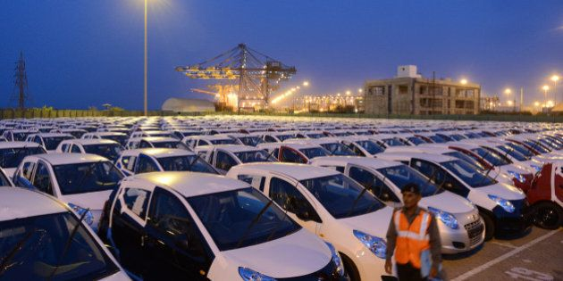 Maruti Suzuki Alto cars to be exported out of India are parked in a holding area at Adani Ports and Special...