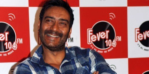 Indian Bollywood actor Ajay Devgn poses as he takes part in a promotional event visit to Fever 104 FM...
