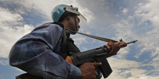 Indian soldier from Rapid Action Force (RAF) stand guard during a protest in Srinagar on August 17, 2010....
