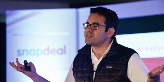 Co-Founder and CEO of Snapdeal Kunal Bahl gestures while addressing the media in Bangalore on April 8,...