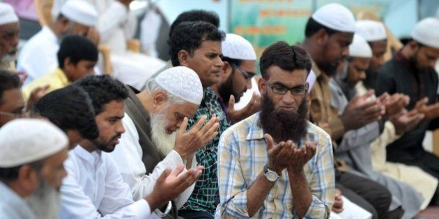Indian Muslims offer special prayers for the death of executed convicted bomb plotter Yakub Memon, at...
