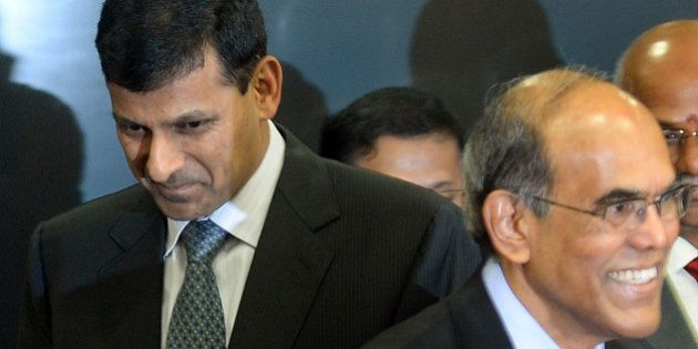 Reserve Bank of India's (RBI) newly appointed governor Raghuram Rajan (L) and outgoing governor Duvvuri...