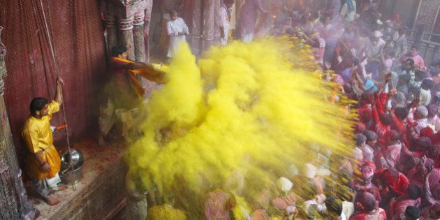 India, people in front of temple during Holi