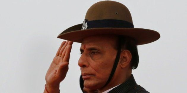 Indian Home Minister Rajnath Singh takes salute as he receives a guard of honor during a visit to a Rapid...