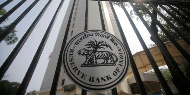 Reserve Bank of India (RBI) logo is displayed on the gate of the RBI headquarters in Mumbai, India, Tuesday,...