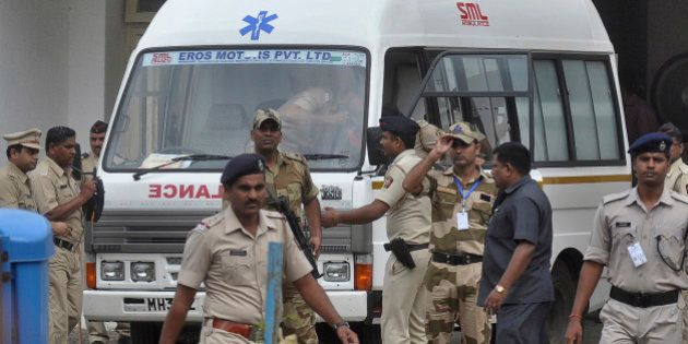 An ambulance carrying the body of Yakub Abdul Razak Memon stands at Dr Babasaheb Ambedkar airport as...