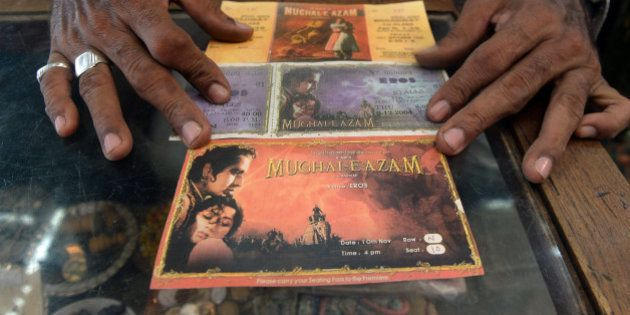 Indian cinema memorabilia dealer Shahid Mansoori displays a print of original movie theatre tickets of...