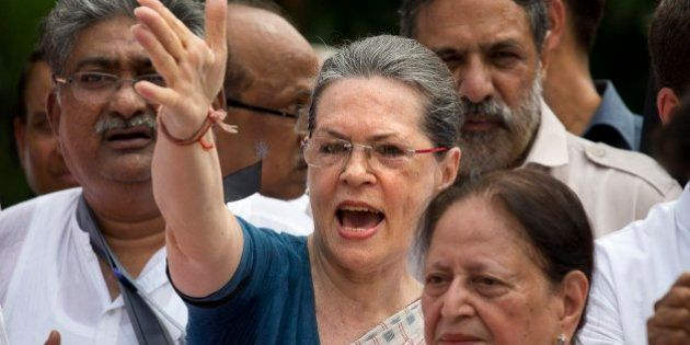 India's opposition Congress party president Sonia Gandhi, centre, and other Congress party lawmakers...