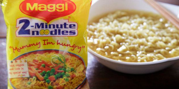 A packet and a cooked bowl of Maggi 2-Minute Noodles, manufactured by Nestle India Ltd., are arranged...