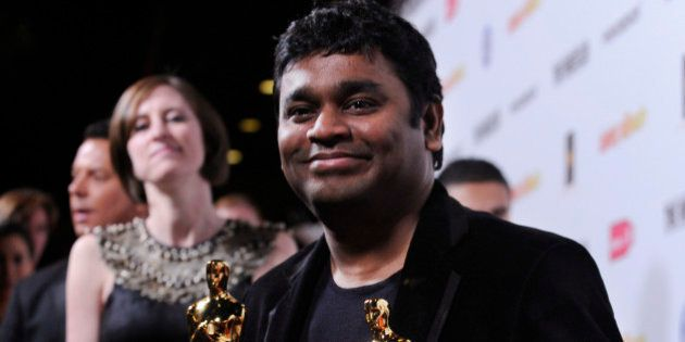 Indian composer AR Rahman holds his two Oscars for Best Song and Best Original Score for