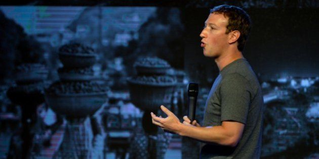 US chairman and chief executive of Facebook Mark Zuckerberg gestures as he announces the Internet.org...