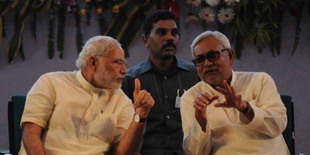 PATNA, INDIA - JULY 25: Prime Minister Narendra Modi interacts with Bihar Chief Minister Nitish Kumar...