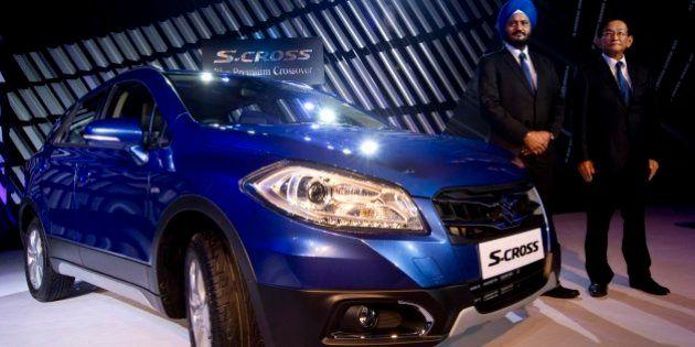 Maruti Suzuki India officials, Managing Director and CEO Kenichi Ayukawa, right, and Executive Director,...