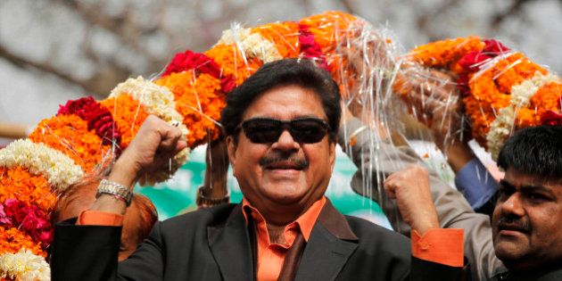 Bharatiya Janata Party leader and Bollywood actor Shatrughan Sinha, is garlanded in an election campaign...