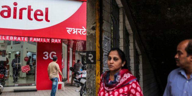 Pedestrian walk past a Bharti Airtel Ltd. store in Mumbai, India, on Saturday, Feb. 28, 2015. The government...